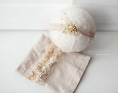 Beige newborn skirt and headband set skirt has beautiful ruffles and headband is embellished with matching ruffle trim, dried gypsophillia,
