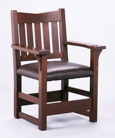 Early Gustav Stickley v-back armchair c1901-1902.  Extra thick early proportions.  Unsigned.  Refinished.