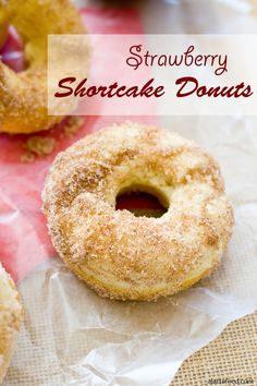 These baked shortcake donuts are dipped in cinnamon sugar and topped with whipped cream and strawberries to make the ultimate strawberry shortcake!