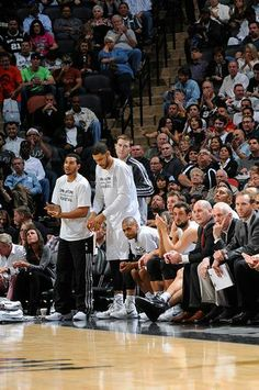 Patty Mills, Marco Belinelli, Greg Popovich, and the San Antonio Spurs team