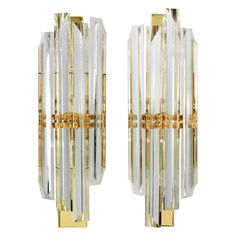 Pair of Elegant Glass Rod Sconces by Sciolari | From a unique collection of antique and modern wall lights and sconces at http://www.1stdibs.com/furniture/lighting/sconces-wall-lights/