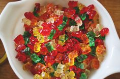 Boozy Gummy Bears- so fun & easy to make! The bears completely absorb the rum or vodka to make a boozy and delicious snack - especially for a party! Drunken Gummy Bears, Vodka Gummy Bears, Fun Drinks, Yummy Drinks, Yummy Food, Drinks Alcohol, Delicious Recipes, Beverages, Festa Party