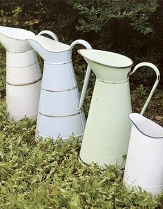 Vintage long necked pitchers from France, serve as watering cans for refreshing floral arrangements.    Outdoor Wedding Ideas