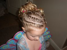 3 slanted parts on top.  Twist.  3 parts on the side.  twist.  pull back into pony tail!