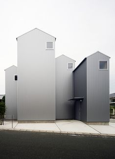 These four house-shaped volumes may look like individual homes but they actually define different areas of the same Japanese residence