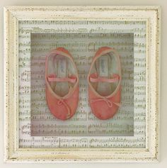 Childs first ballet shoes framed in a deep white distressed frame, with a gorgeous white/gold music mount.