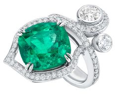 Greenfire Ring - by Boodles. An 8.65 carat cushion cut Columbian emerald set in platinum and surrounded by round brilliant cut diamonds