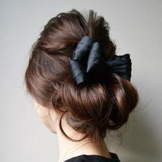 bow and a messy updo