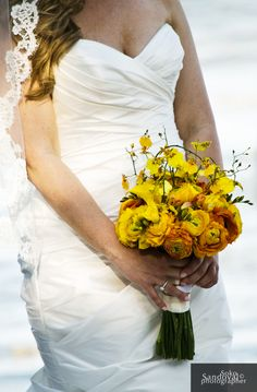 I heart smoosh this bouquet ... yellow and orange calla lilies, orange and yellow ranunculus and yellow oncidium orchids