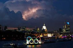 The Olympic rings on the River Thames against the skyline as a storm is rolls in over London.