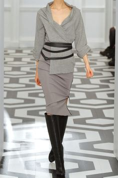 Victoria Beckham dress: light-gray cashmere-blend top, raw-edged wrap, V-neck, turned-up three-quarter length sleeves, four-strand black leather belt with ribbon ties, black jersey insert at bodice, lavender stretch-crepe skirt. Exposed zip fastening at side. Fabric1: 97% cashmere, 2% polyamide, 1% elastane; fabric2: 86% viscose, 10% polyamide, 4% elastane; trim: 100% silk. Specialist clean. Designer color: Clay/Cement.