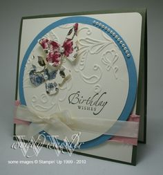 embossed circle with butterflies