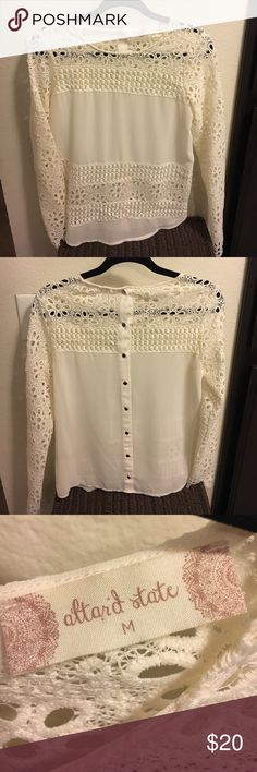Fun sheer and lace top. Never been worn! This top is sheer with lace and fun buttons in the back. Altar'd State Tops Blouses