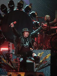 AXL ROSE broken foot. He's pumped: The November Rain crooner put both arms up when the crowd cheered