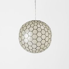 From sea to ceiling. Handcrafted in the Philippines, the capiz shells on the Capiz Orb Pendants are individually hand-cut and set within a pewter frame. Pendant Lamp, Pendant Lighting, Ceiling Lamp, Ceiling Lights, I Love Lamp, Contemporary Pendant Lights, Modern Contemporary, Home Decor Lights, Linen Bedding