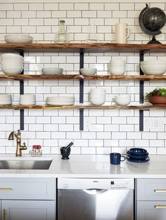 it's an industrial companion to the gorgeous (and pricey) faux-marble Caesarstone countertops. The placement of the sink, dishwasher, and open shelving (also from 3 Dot Design) has made the cleanup flow effortless | archdigest.com