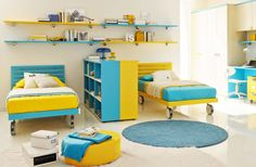 colorful blue and yellow childrens twin beds with other furniture