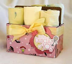 Baby blankets rolled up in decorated drink carrier #Baby #BabyShower