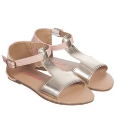 Girls elegant gold and dusky pink sandals by<span>Billieblush made from a soft artificial leather. They have a flat sole, ankle strap that fastens with a buckle at the side and rubber non-slip sole.<br /></span> <ul> <li>Imitation leather upper</li> <li>Non-slip sole</li> <li>Buckle ankle fastening</li> </ul>