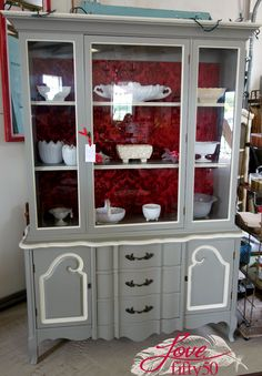 1950's French Provencal China Hutch finished in Pure Earth Paint Jezebel accented with Champagne Ice. Fabric adhered with Pure Earth Paint Gel Medium