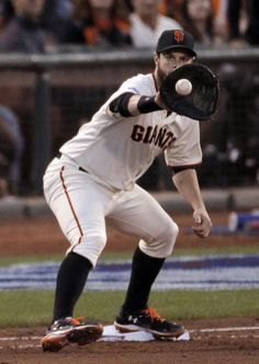 Giants Brandon Belt catches a ball fielded by Giants Joe Panik for an out in the fourth inning during game three of the World Series at AT&T Park in San Francisco, California., on Friday Oct. 24, 2014. Photo: Carlos Avila Gonzalez, The Chronicle