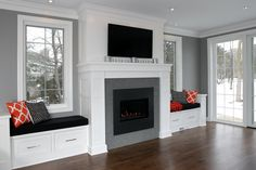 Full height wood surround with symmetric bench window seats