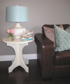 I like the brown leather furniture with a grey wall, and the popular theme seems to be white and blue accents
