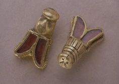 Bees in gold belonging to King Childeric I (c. 440-481/82 CE). Head and throat are in gold, while the wings are encrusted in garnet