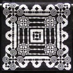 """Crazy in Black & White, by Geraldine Nall. This quilt is small, perhaps a foot on each side. From the artist's statement, """"It has 6,300 pieces and consists of 140 1.5″ and 2.5″ square pineapple blocks.""""  WOW!"""