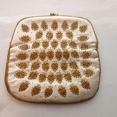 A personal favorite from my Etsy shop https://www.etsy.com/listing/234683901/vintage-clutch-handbag-handmade-artisan