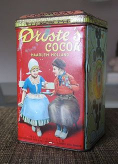 """Vintage lithographed Droste's cocoa tin from the 1930s/1940s. by RichRelations, $33.00 This vintage lithographed Droste's Cocoa tin dating   has the delightful patina from years of enthusiastic use, some scratches and rusting on the interior, but has bright colors and a charming scene of two dutch children sharing cocoa. A wonderful item for those evoking a vintage kitchen feel, or for set decorators seeking authentic items for a period kitchen. 5.5"""" tall and 3.5"""" wide."""