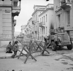 A Humber armoured car supports paratroops during operations against ELAS in Athens, 6 January 1945.