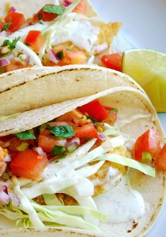 healthier Baja Fish Tacos - Marlene Koch  slimmed down version of the popular Baja-style fish taco offers all of the terrific texture and flavor with half the fat, calories, carbs and sodium! Best of all, they are every bit addictive as the original! Nutrition Information Per Serving (2 tacos) Calories 300 | Carbohydrate 31g (Sugars 4g) | Total Fat 7 (Sat Fat 1g) | Protein 27g | Fiber 5g | Cholesterol 55mg | Sodium 500mg
