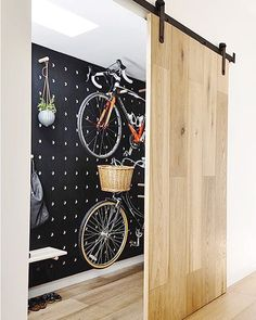 Amazing space-saving cool bike storage ideas for small room and apartments. These indoor bike storage solutions are for pedal pushers who can't p Gray Interior, Interior Barn Doors, Interior And Exterior, Interior Design, Modern Interior, Design Garage, Door Design, House Design, House Ideas
