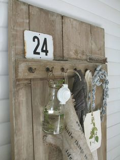 rustic display with barn door, hooks, burlap. awesome in an entry way.
