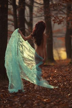 This pose would be perfect on our acres private boudoir ranch in Santa Paula CA. Nude girl walking through trees with sheer fabric.