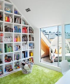 For a kids library i really like the idea of color coding books.Adventurous Design Quest: Attic apartment in Sweden by Kanozi Arkitekter Stockholm Apartment, Attic Apartment, Attic Rooms, Bookshelves Built In, Bookcases, Built Ins, Bookshelf Wall, Home Libraries, Kids Storage