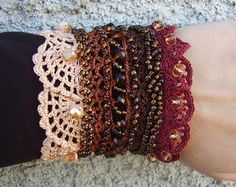 Handmade crochet cuff bracelet with 100% cotton thread. There are used different crochet techniques in creating this cuff bracelet – Irish crochet, free form crochet and several lace crochet patterns.   It is a unique cuff bracelet in boho style with a little vintage look.  There are five big and four smaller different type of flowers to decorate the cuff bracelet.  The main colors are blue, ivory white, siena beige, coffee brown.  Material is 100 % cotton thread.  This vintage cuff bracelet…