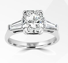 Simply Radiant. A large fancy modified radiant cut is flanked by matched tapered baguettes, in platinum, fully hand made. #charlesrosejewellers #engagement #diamonds #sayyes #weddings # summer #forever