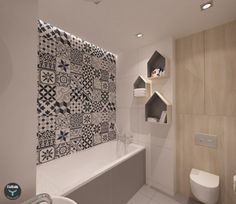 Płytki cementowe  Articima Patchwork BWG (czarno-szaro-biały) zastosowane na ścianie w łazience oraz na podłodze w kuchni.