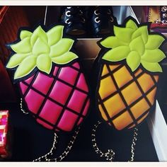 These colorful pineapple purses from Moschino would be great for summer.