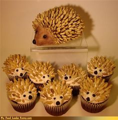 hedgehog cakes...looks like almond slivers, currants, & choc-chip noses, w/ coca powder tinting on the bigger one.