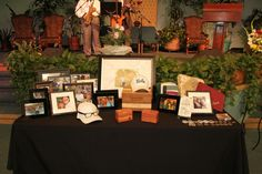 Beautiful memory table at a Celebration of Life memorial www.eternallyloved.com