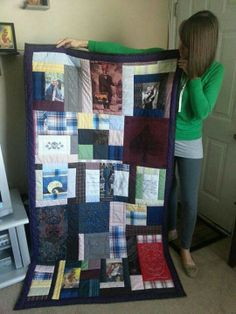 This is a memory quilt of my husbands shirts. I also used photos & our wedding invitation. In loving memory of my husband John.