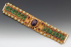 Maggie Meister: Olbian Treasure Bracelet The Olbia Treasure Hoard (5th Century Crimea) at the Walters Art Museum in Baltimore, Maryland played muse to this exquisite piece. Rich color illuminates garden-like rows of leaf and bloom. For resplendent wrists.  Hand-carved ruby scarab, amazonite, glass seed beads and 24 kt. Gold-plated seed beads.