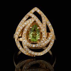 Luca Carati Pear Shape Design Cocktail Ring Features a 1.01 Carat Pear Cut Peridot in the Center of 0.50 Total Carat Weight of Diamonds with FG VS Quality set in 18Kt Yellow Gold.  The bold pear shape top of ring measures 1 x .75 inches.