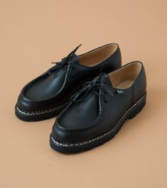 Classic Paraboot Michael in black leather. Features leather upper, durable  rubber sole, leather lined inner, cushioned footbed and Paraboot tag on  side. Norwegian Welt Construction.  Color: Black  Material: Leather Upper with Rubber Sole  Made in France