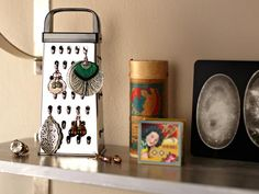 Teenage Girl's Goth-Style Bathroom: A sparkling-clean cheese grater makes for some very clever earring storage with an industrial feel. Cheaper than a fancy jewelry organizer, this conversation piece can hold a lot of earrings. From DIYnetwork.com