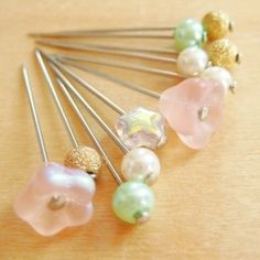 DIY Glass Head Sewing Pins - Make your sewing pins easier to use by adding a glass bead to the top