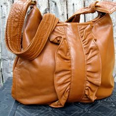 ReFind Originals upcycled leather shoulder bag. $275.00. This bag is cute in every color!